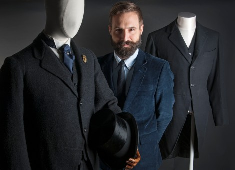 Fashion Curator, Tim Long, with suits from Museum of London's me