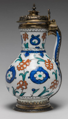 Fritware Jug. Unknown Maker. Painted red slip, blue green and black under a colourless, slightly pitted glaze, silver gilt mounts. Height, whole, 26.2 cm, width, whole, 14.2 cm, diameter, rim, 7.7 cm, diameter, base, 9.8 cm, weight, whole, 780 g. Jug: Ottoman Period, Islamic. Production Place: Turkey. Mounts: Elizabethan, circa 1580-1593. Production Place: London.