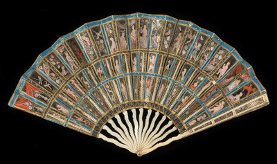 The Messel Mica Fan. Folding fan, the leaf composed of three bands of mica panels, mounted in double paper, painted in bodycolour and gilt. Ivory sticks of serpentine form; guards of ivory, the lower part serpentine, the upper part pierced by three panels backed with mica mounted in paper. Brass rivet. Front. The mica panels are painted in colours with different motifs including: floral sprays, flowers in vases, flowers with a bird, flowers with a dog, a dog with a bird, a bird with a dragonfly, a butterfly, a boy with a butterfly, a boy playing a pipe, a Cupid holding a heart, a Cupid brandishing an arrow, a seated boy, a female bust; some occurring more than once, but not identically. The horizontal paper borders between the panels are painted alternately black and blue with gilt ornament. Height (guards) 25.8 cm, width (whole) 45.0 cm, circa 1665 to 1700. Production Place: West Europe.