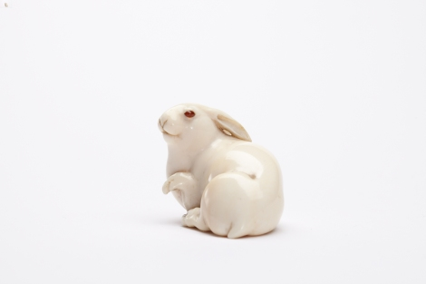 Attributed to Sawaki Rizo Masatoshi The Hare with Amber Eyes Ivory netsuke of a hare with raised forepaw. Eyes inlaid in amber coloured buffalo horn. Signed Masatoshi. Osaka, Japan, c.1880 3.7 cm long Collection of Edmund de Waal Photographer: Michael Harvey